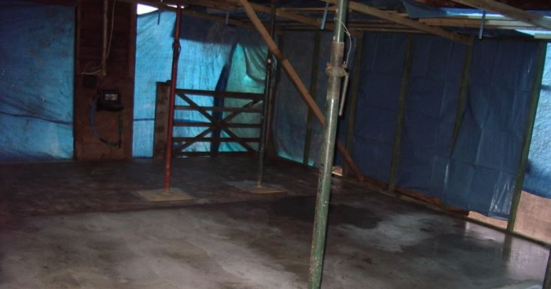 Inside the shell of the old stable block with all the interior removed and our new floor laid.
